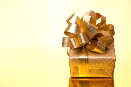 Christmas gift box on a golden background, horizontal photo