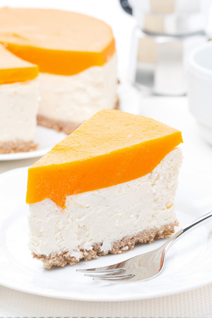cheesecake with pumpkin jelly, vertical, close-up photo