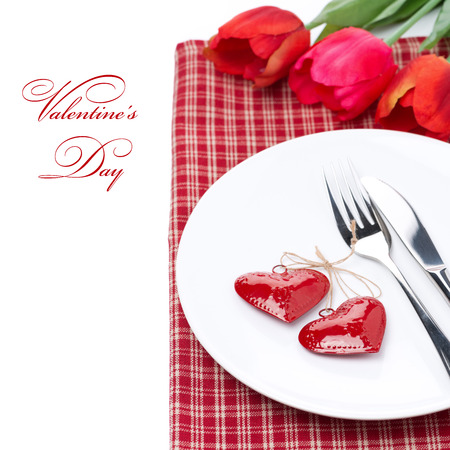 Festive table setting for Valentine's Day with tulips, close-up, isolated on white