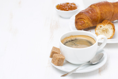 cup of black coffee and croissants (with space for text), horizontal
