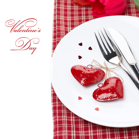 Festive table setting for Valentines Day, isolated on white photo