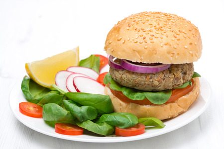 vegetarian hamburger: vegetarian burger with fresh salad on the plate Stock Photo