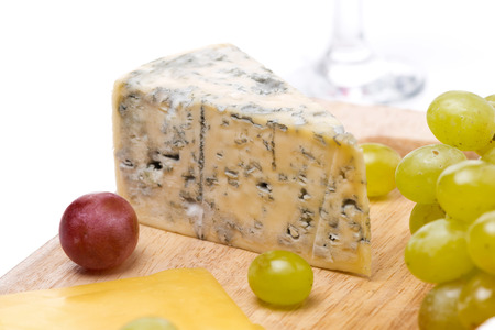 blue cheese and grapes, close-up, selective focus photo