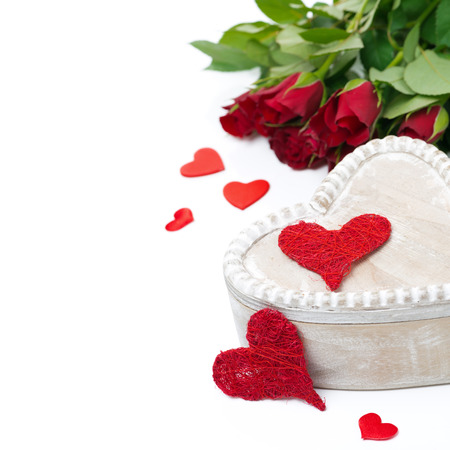 wooden box, red hearts and roses for Valentines Day, isolated photo