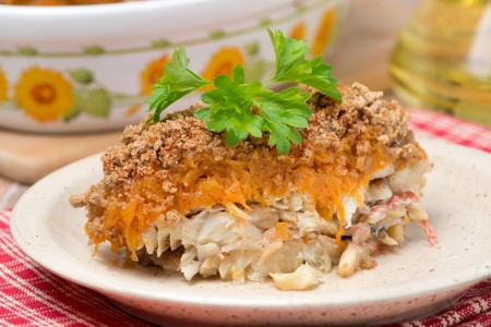 pumpkin pie: Gratin with fish and pumpkin on a plate, close-up, horizontal