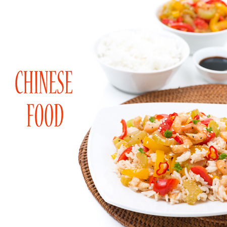 Chinese food - rice with vegetables and shrimps on a plate, isolated on white photo