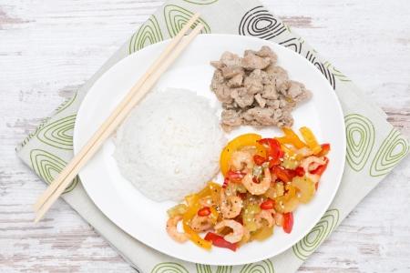 Chinese food - rice, chicken and vegetables with shrimp, top view, horizontal photo