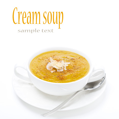 cream soup of yellow lentils in a white bowl, isolated on white photo