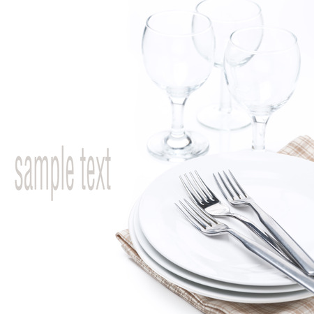 tableware for dinner - plates, forks and glasses, isolated on white