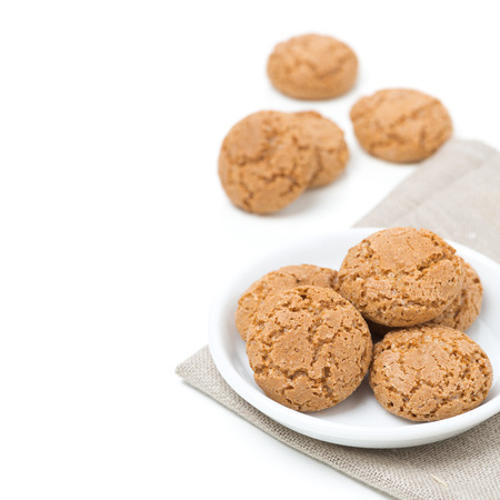 amaretto: biscotti cookies in a bowl isolated on white, close-up