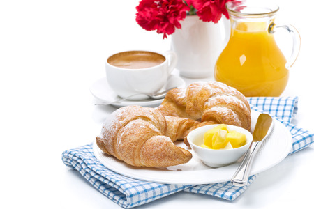 croissants with butter, cup of coffee and orange juice for breakfast, isolated