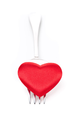 valentines day mother s: red heart on a fork, concept, isolated on white