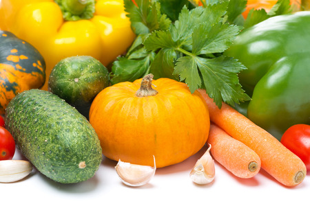 Assorted fresh seasonal vegetables and herbs, isolated on white background photo