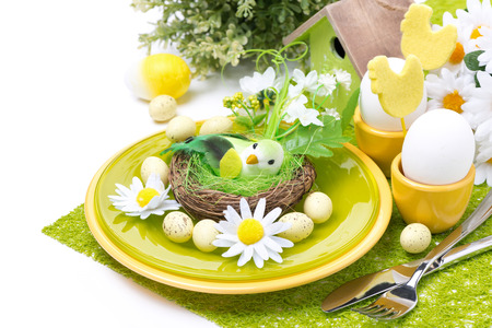 Festive Easter table setting with decorations and flowers, isolated on white photo
