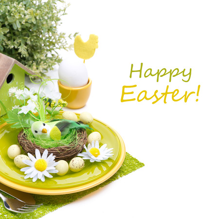 Festive Easter table setting with decorations, egg and flowers, isolated on white photo