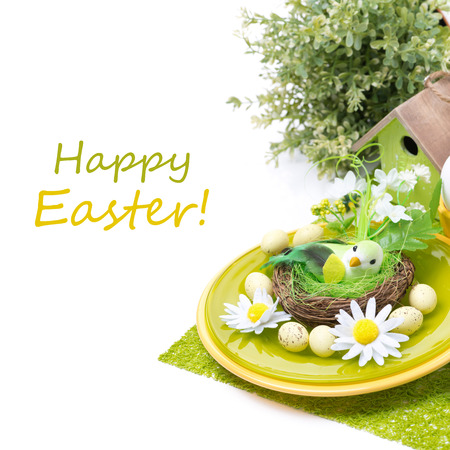 Festive Easter table setting with decorations, isolated on white photo