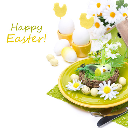 Festive Easter table setting with eggs and flowers, isolated on white photo