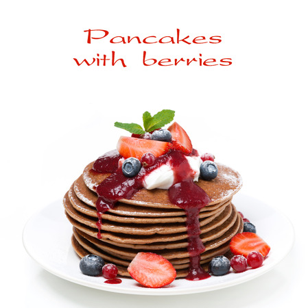 pancakes with cream and berries, close-up, isolated on white photo