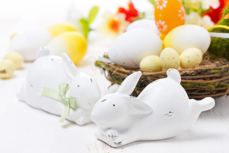 Easter rabbits and basket with eggs, horizontal photo