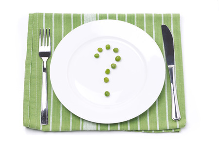 empty plate with green peas in the shape of a question mark, concept, isolated on white