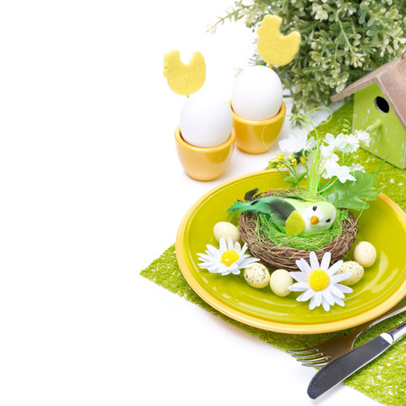 Festive Easter table setting with decorative ornaments, isolated on white photo