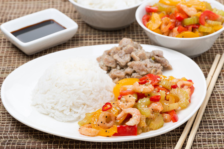 Chinese food - white rice, chicken and vegetables with shrimp, horizontal photo