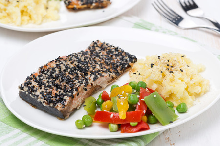 pink salmon fillet in sesame, vegetables and mashed potatoes, close-up photo