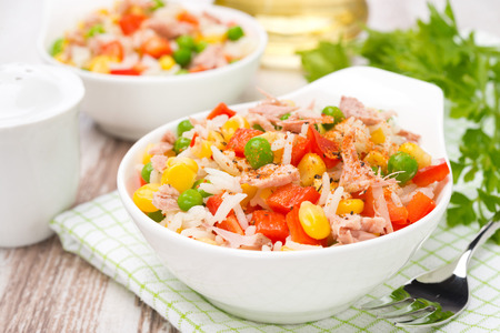 colorful salad with corn, green peas, rice, red pepper and tuna photo