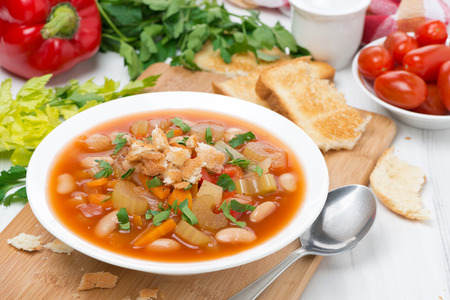 beans soup: minestrone with vegetables, beans and croutons in a plate, close-up Stock Photo