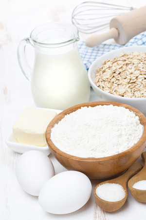 flour, butter, cereal and ingredients for baking, vertical photo