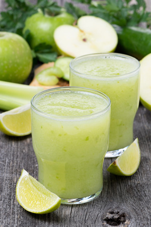 Smoothies of green apple, celery and lime, vertical