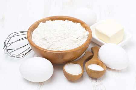 flour, salt, sugar, butter and eggs for baking pancakes, close-up photo
