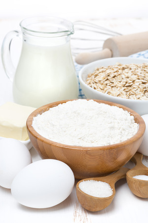 milk, cereal and ingredients for baking, close-up, vertical photo