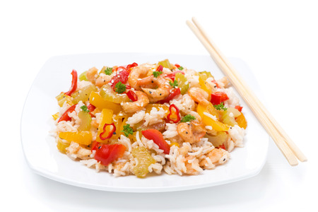 rice with vegetables and shrimps on the plate, isolated on white photo