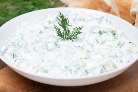 yoghurt sauce tzatziki with herbs, cucumber and garlic, close-up