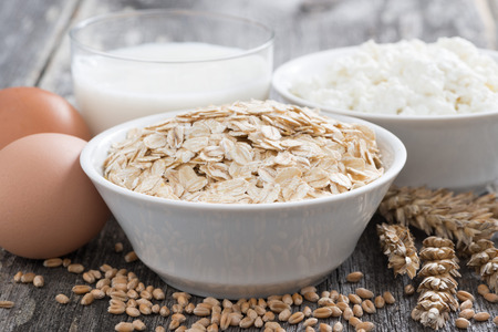 fresh products - oatmeal, eggs, cottage cheese and milk, close-up photo
