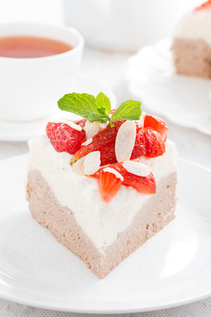 piece of cake with whipped cream and strawberries close-up, vertical, close-up photo