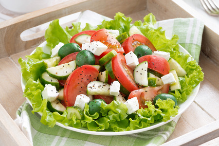 salad fork: plate of green salad with vegetables, top view, horizontal