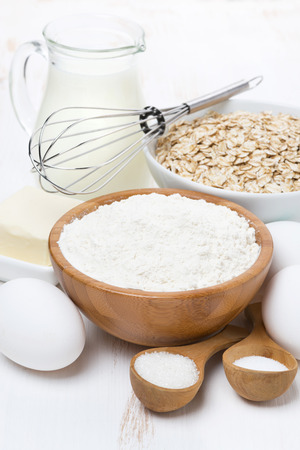 milk, cereal and ingredients for baking, vertical photo