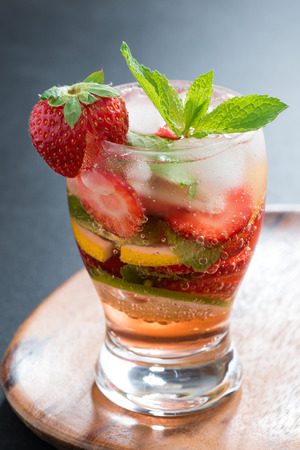 refreshing cocktail with strawberry and citrus, vertical, close-up photo