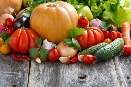 harvest of seasonal fresh vegetables on wooden background and place for text, horizontal photo
