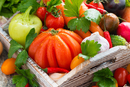 harvest seasonal vegetables in a wooden box, horizontal, close-up photo