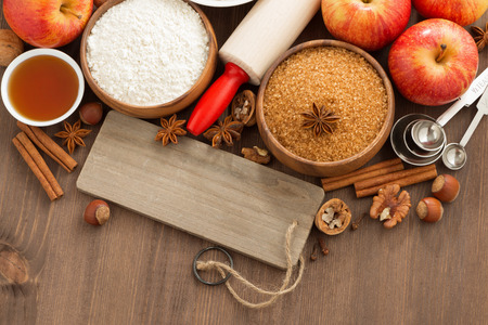 baking ingredients: ingredients for baking apple pie and a wooden nameplate, top view, horizontal