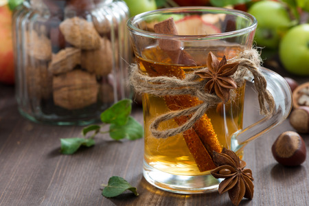 punch spice: apple cider with spices in a glass cup, close-up, horizontal Stock Photo