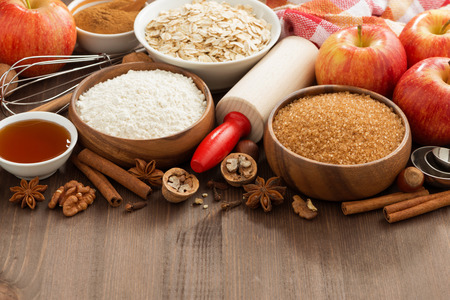 ingredients for baking cake on a wooden background, horizontal, close-up photo