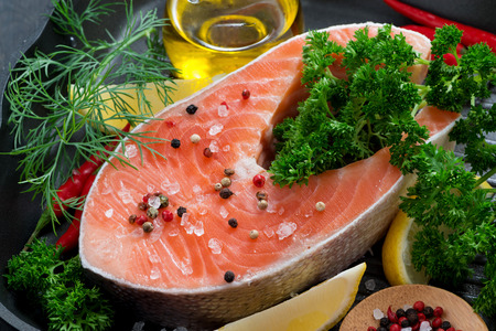fresh salmon steak and ingredients for cooking on a grill pan, close-up, horizontal photo