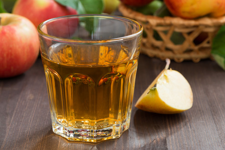 grog: autumn drink - apple cider or juice in a glass, horizontal