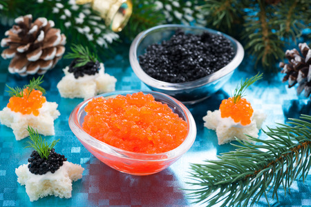 Christmas appetizers - red and black caviar, close-up photo