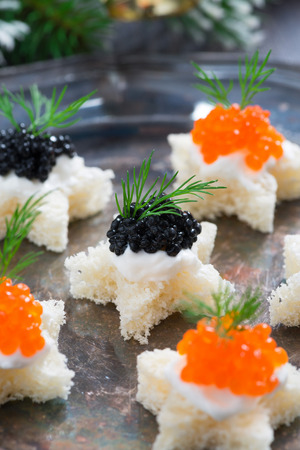 Christmas appetizers with bread and caviar, selective focus, close-up photo