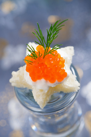 canape with red caviar for Christmas, close-up photo